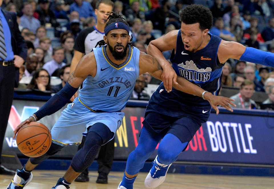 <span><strong>Memphis Grizzlies guard Mike Conley (11) drives against Dallas Mavericks guard Jalen Brunson in the second half of an NBA basketball game Monday, Nov. 19, 2018, in Memphis, Tenn.</strong> (AP Photo/Brandon Dill)</span>