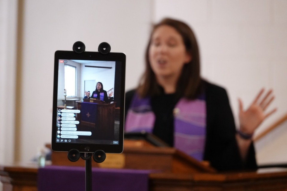 <strong>Rev. Sara K. Corum, pastor at Trinity United Methodist Church in Memphis, preaches to her congregation in a livestream on Sunday, March 22, 2020, from an empty room in her midtown church. The church was closed to worshippers due to the COVID-19 pandemic.</strong> (Karen Pulfer Focht/Special to the Daily Memphian)
