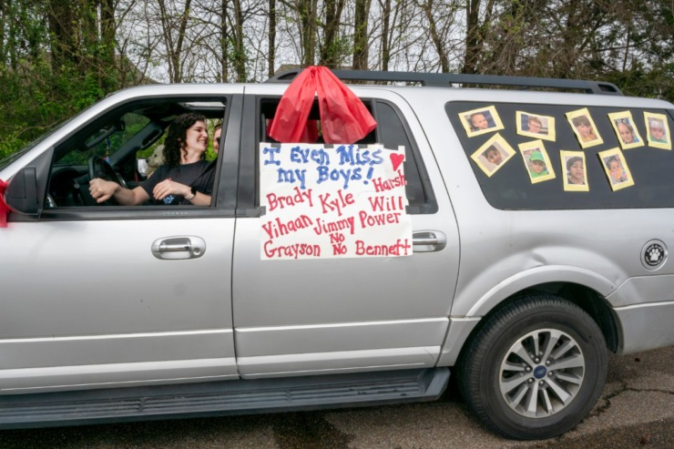 <strong>Marci Nobert, kindergarten teacher at Bailey Station Elementary School, and her daughter Mallory get ready to caravan with other teachers through the neighborhoods of her students to show support for the students during the COVID-19 virus outbreak. Collierville Municipal Schools were on Spring Break last week and will be off until further notice.</strong> (Greg Campbell/Special for The Daily Memphian)