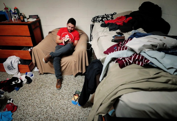 <strong>CBU engineering student Luiz Parolini Dutra, like many other international students, is languishing in the dorm on March, 24, 2020, as he begins remote course work. Luiz says he had packed up all his belongings because he thought he was going to have to switch rooms, but it didn't happen so now everything is a mess. He spends a lot of time in the cafeteria where food service is still operating, but calming the anxiety and boredom is a one-person show.</strong> (Jim Weber/Daily Memphian)