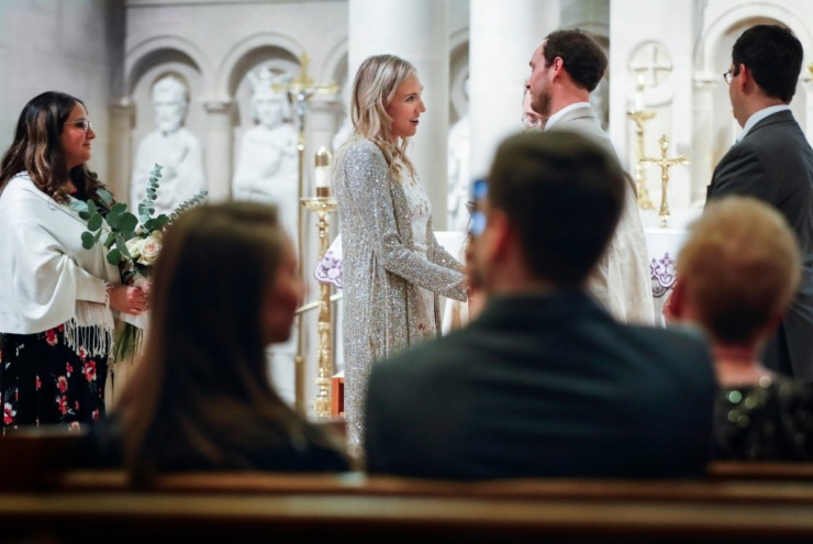<strong>Holly Whittle (left) gazes at her bridegroom John Steinert during their wedding on Saturday, March 21, 2020 at St. Louis Catholic Church.</strong> (Mark Weber/Daily Memphian)