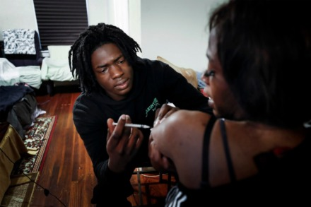 <strong>Therron Farsee Jr. gives his mother, Dinishia Jones, her first insulin shot in nearly a month on March 24, 2020. HER Faith Ministries helped Jones obtain her medication, which costs more than $300.</strong> (Mark Weber/Daily Memphian)
