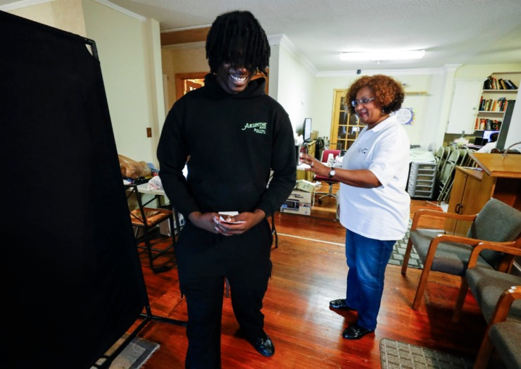 <strong>HER Faith Ministries founded by Rev. Dr. Elaine Sanford (right) looks over Therron Farsee, Jr. to see that he is presentable before he heads off to check on the status of job applications on Tuesday, March 24, 2020.</strong> (Mark Weber/Daily Memphian)