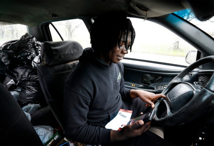 <strong>Therron Farsee, Jr., looks up directions to AutoZone on Tuesday, March 24, 2020. Farsee, who submitted several job applications online wanted to show his face to managers to show how serious he was about getting a job.</strong> (Mark Weber/Daily Memphian)