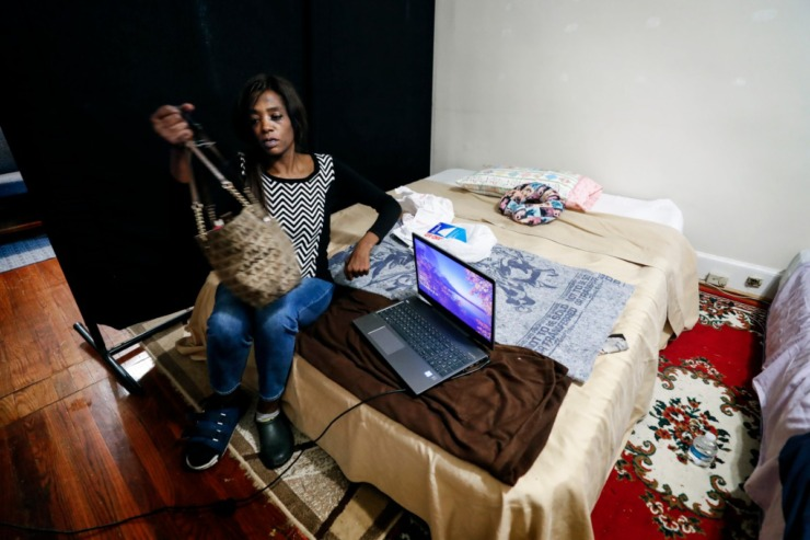 <strong>Dinishia Jones sits on a blowup mattress were she has laid her head for nearly a week after HER Faith Ministries provided a place for to stay during the the coronavirus outbreak.</strong> (Mark Weber/Daily Memphian)