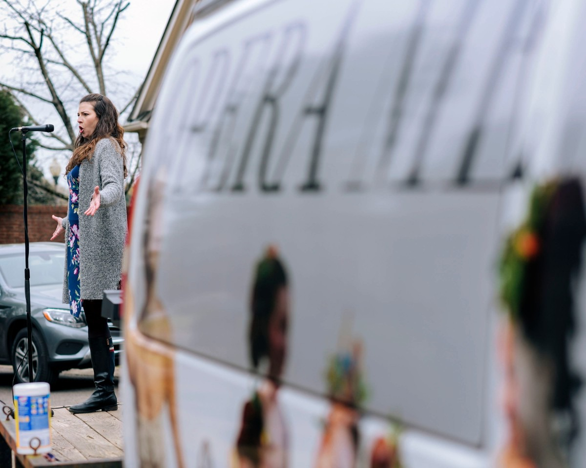 """<strong>Helen Hassinger, a soprano for Opera Memphis, performs in the Red Acres neighborhood on Saturday, March 21, 2020. Opera Memphis took vocalists to neighborhoods, as people follow """"Safer at Home"""" precautions.</strong> (Houston Cofield/Special to The Daily Memphian)"""