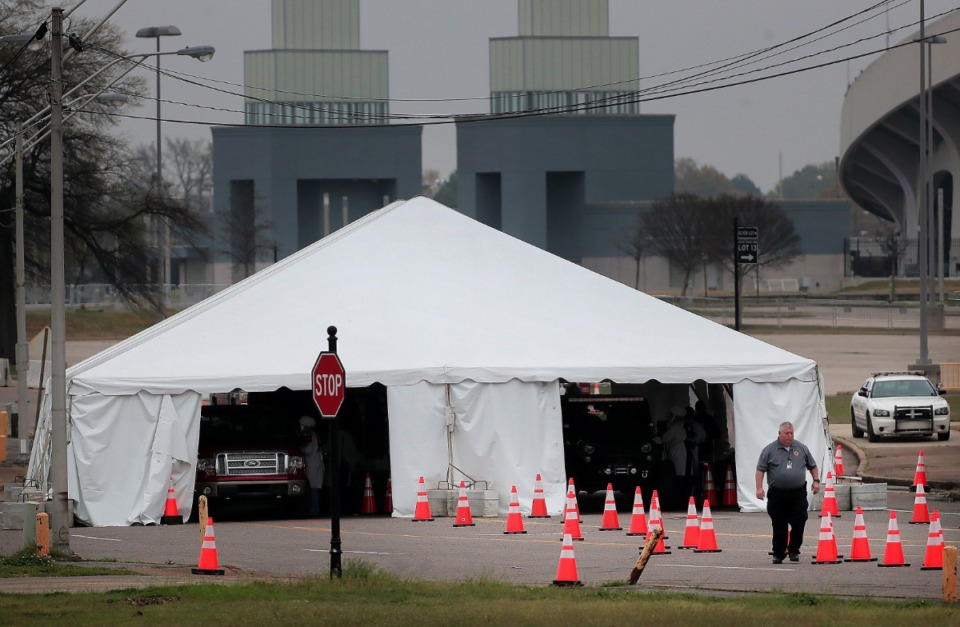 <strong>Staff and students from the University of Tennessee Health Science Center work with the Shelby County Health Department on March 25, 2020, to continue drive-thru testing for COVID-19 at the Memphis Fairgrounds.</strong> (Jim Weber/Daily Memphian)