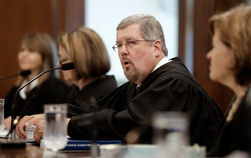 <strong>Tennessee Supreme Court Chief Justice Jeff Bivins, seen here second from right in Nashville in 2018, has suspended most in-court hearings until April 30.&nbsp;</strong>(Mark Humphrey/Ap file)