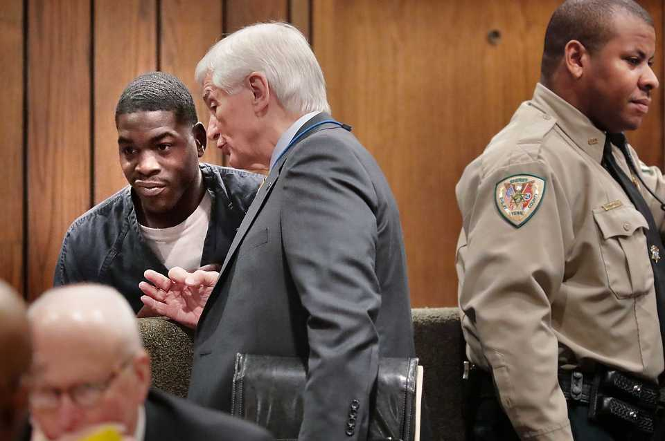 <strong>McKinney Wright Jr. (left) talks with his lawyer Bill Massey in Judge Karen Massey's court on Nov. 20, 2018. Wright, 22, and Quandarius Richardson, 18, two of the three suspects accused of killing Greater Memphis Chamber CEO Phil Trenary on Sept. 27, 2018, waved a preliminary hearing in General Sessions court.</strong> (Jim Weber/Daily Memphian)
