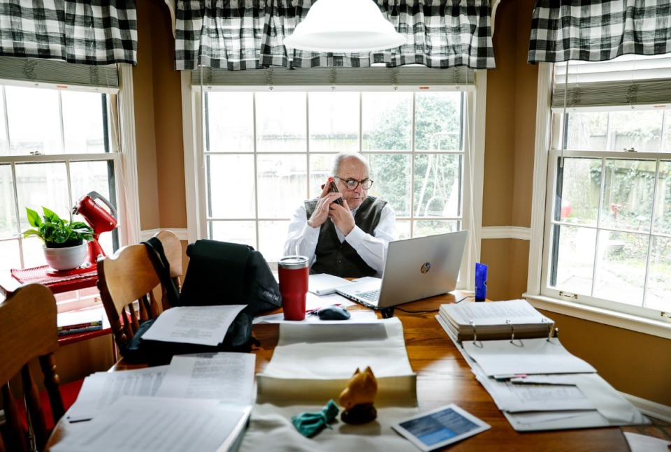 <strong>Bartlett mayor Keith McDonald fields calls from his kitchen table while working at home on Wednesday, March 25, 2020. McDonald and his wife have been under self-imposed quarantine after they attended a meeting in Washington, D.C., in which someone had the coronavirus.</strong> (Mark Weber/Daily Memphian)