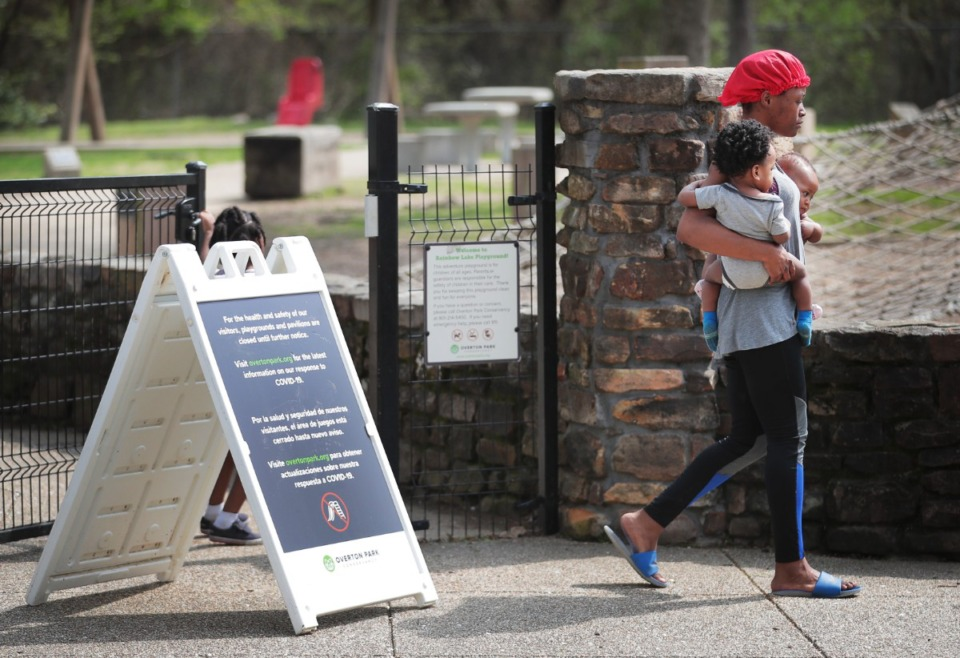 <strong>A sign at the Overton Park playground explains why the playground is closed, but some Memphians were ignoring the warning on Friday, March 27, 2020, which is one of the reasons why city officials have threatened to shutter parks entirely.</strong> (Jim Weber/Daily Memphian)