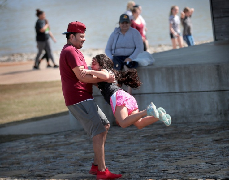 <strong>Erik Cortes spins his niece Anabella Garcia, 8, like a dervish at Shelby Farms on March 26, 2020, as Memphians emerge from their sheltering-in-place to enjoy a budding spring day after weeks of poor weather and worse news have conspired to keep most folks indoors.</strong> (Jim Weber/Daily Memphian)