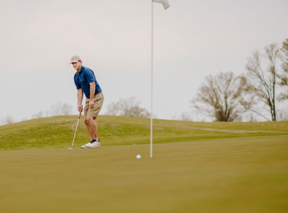 <strong>Ryan Porter grimaces after barely lipping out a long putt for birdie on March 27, 2020. Mirimichi Golf Course has received permission from the county to open and to no longer be considered a nonessential business.</strong> (Houston Cofield/Special to The Daily Memphian)