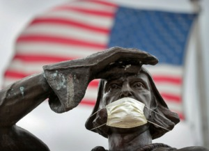 <strong>The bronze statue of famous Italian explorer Christopher Columbus got a little virus protection of his own after someone attached a mask overnight on March 28, 2020, at Marquette Park. The number of confirmed cases of COVID-19 has climbed over 300 in the greater Memphis area, with over 1,200 in the state of Tennessee.</strong> (Jim Weber/Daily Memphian)