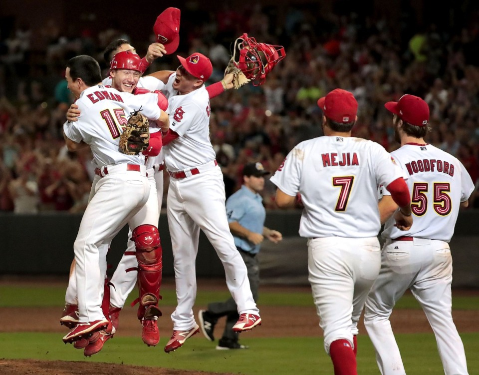 <strong>Redbirds players storm the mound to celebrate after winning game four of the Redbird's Pacific Coast League series against Fresno at Autozone Park on Sept. 15, 2018. Memphis beat the Grizzlies 5-0 to win their second straight PCL title.</strong> (Jim Weber/Daily Memphian file)