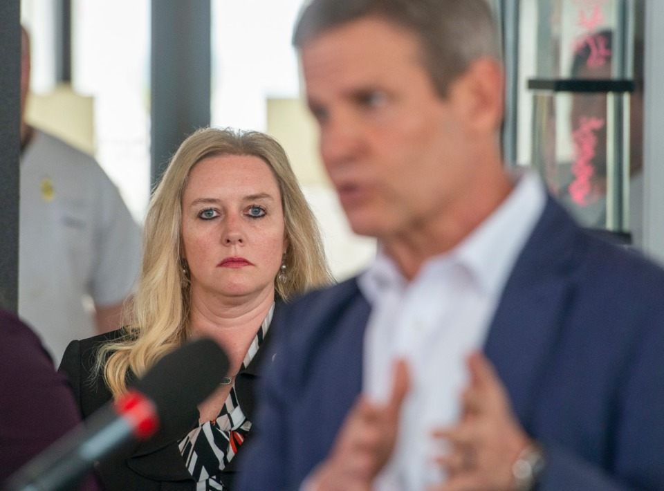 <strong>Dr. Lisa Piercey, Commissioner of the Tennessee Department of Health, listens to Gov. Bill Lee gives his daily briefing at Memphis International Airport Friday, March 27, 2020.</strong> (Greg Campbell/Special to The Daily Memphian)