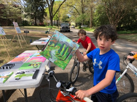 <strong>Anthony Mascioli, 10, painted a scene from Glacier National Park and delivered it on bike Sunday afternoon to the show in Chickasaw Gardens. (<em>Photo by Jane Roberts)</em></strong>