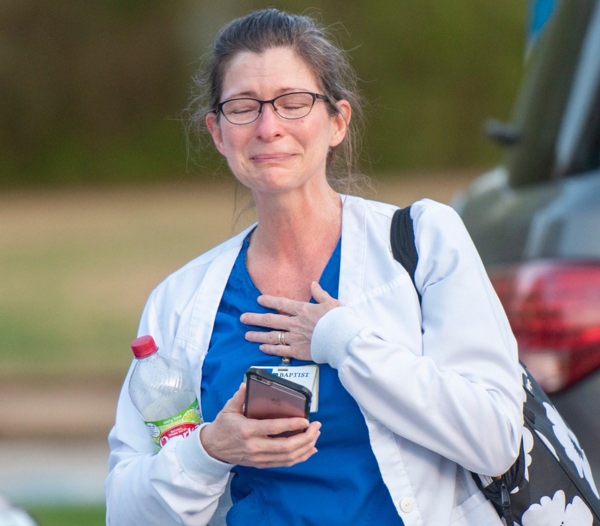 <strong>The kind gesture overwhelms registered nurse Sharon Gant.&nbsp; A group gathered to show their gratitude to health care workers Sunday night, March 29, 2020 outside Baptist Memorial Hospital-Collierville.&nbsp;</strong>(Greg Campbell/Special to The Daily Memphian)