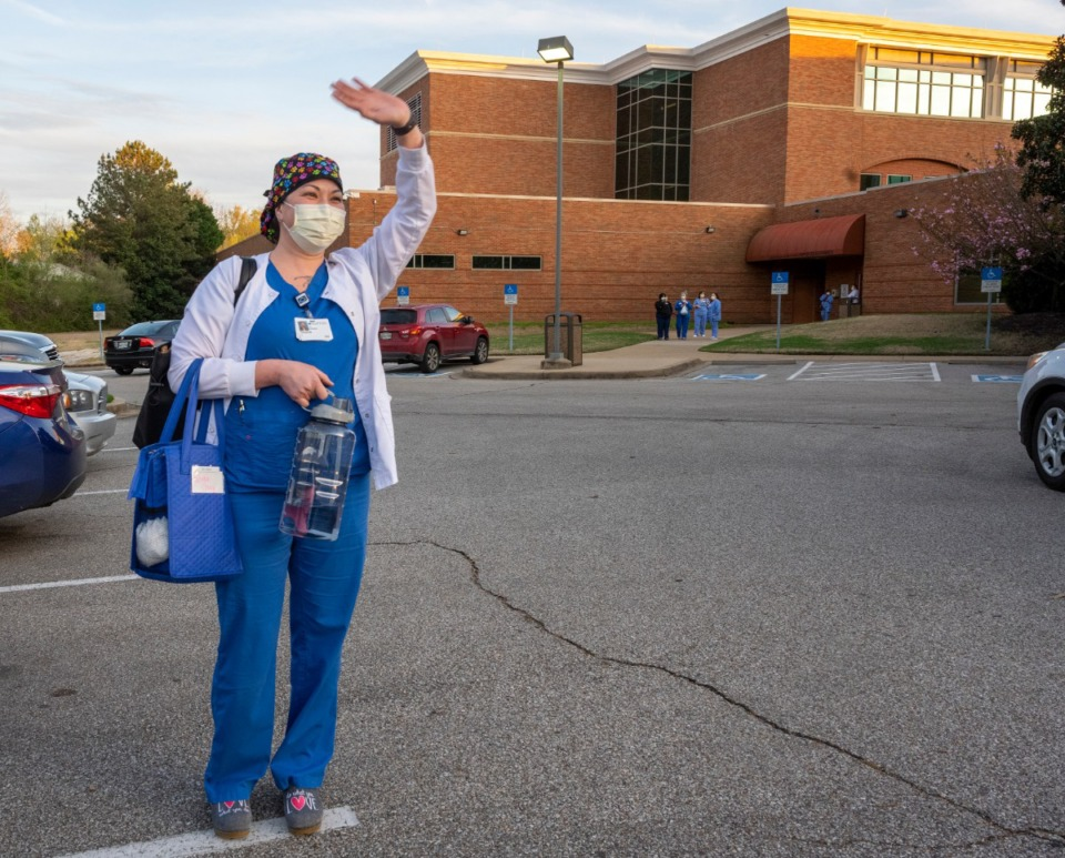<strong>Trisha Gray, R.N. waves at the supporters gathered at Baptist Memorial Hospital-Collierville Sunday, March 29, 2020. A group showed up Sunday at shift change to express their appreciation to the health care workers.</strong> (Greg Campbell/Special to The Daily Memphian)
