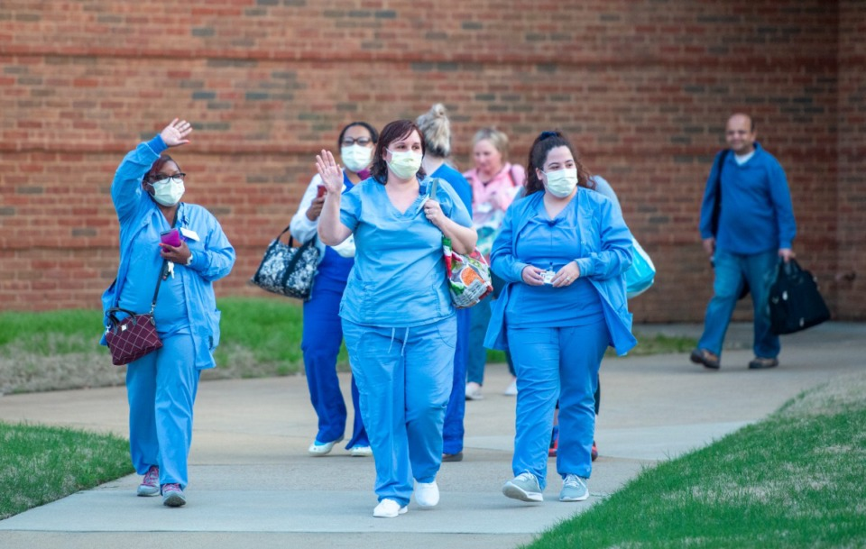 <strong>Nurses and staff exit Baptist Memorial Hospital-Collierville after their shift Sunday night, March 29, 2020. A group showed up with signs of encouragement to show their appreciation for the health care workers.</strong> (Greg Campbell/Special to The Daily Memphian)