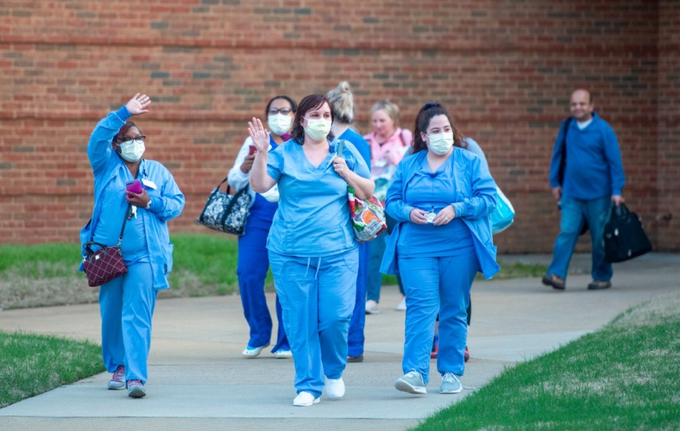 <strong>Nurses and staff exit Baptist Memorial Hospital-Collierville after their shift Sunday night, March 29, 2020. A group showed up with signs of encouragement to show their appreciation for the health care workers.</strong> (Greg Campbell/Special for The Daily Memphian)