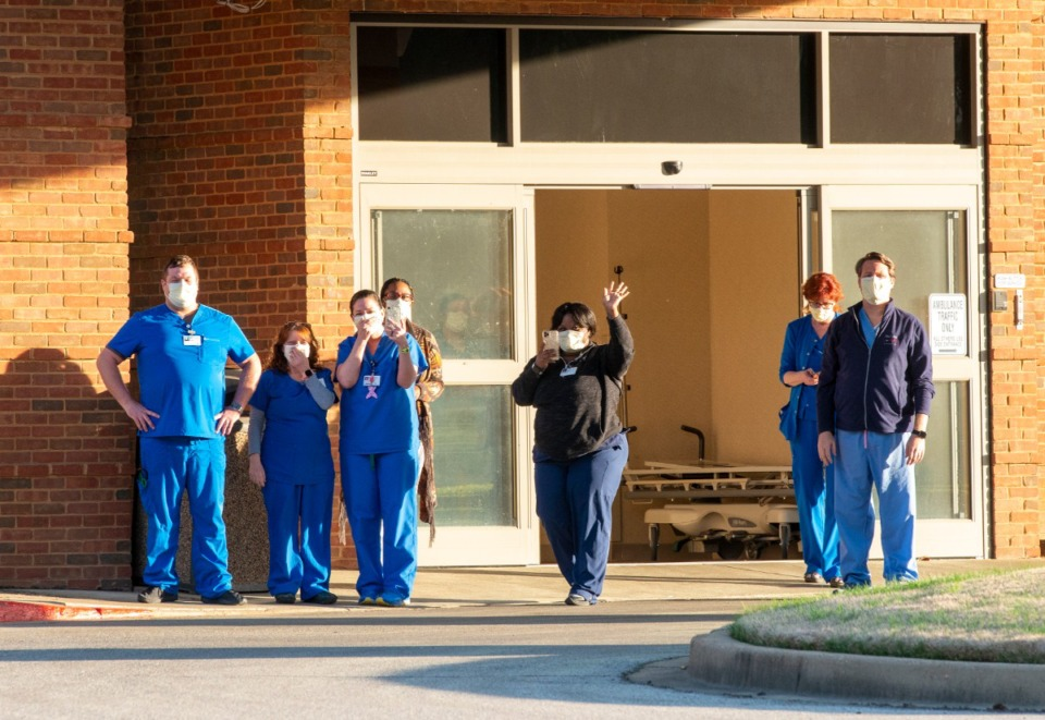 <strong>ER staff at Baptist Memorial Hospital-Collierville come out of the hospital to view the signs and supporters gathered to show their appreciation for the health care workers, Sunday, March 29, 2020.</strong> (Greg Campbell/Special to The Daily Memphian)
