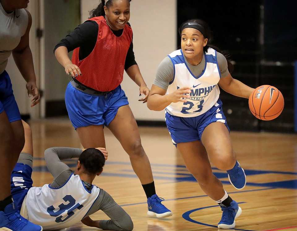<strong>University of Memphis point guard Jamirah Shutes (23), one of the standouts on this year's Tigers team, runs defensive drills on Nov. 14, 2018, at the Elma Roane Fieldhouse.</strong> (Jim Weber/Daily Memphian)