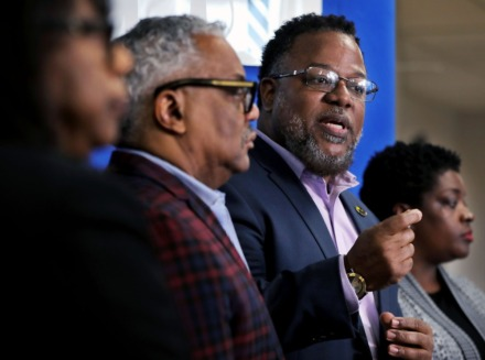 <strong>Tennessee State Rep. Antonio Parkinson (center) met with North Memphis leaders including Memphis City Councilwoman Rhonda Logan (right) to address the potential effect of the coronavirus pandemic earlier in March at Golden Gate Cathedral church, where Ed Stephens (left) is bishop.</strong> (Patrick Lantrip/Daily Memphian)