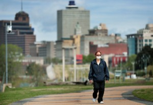 <strong>Downtown Memphis resident Lea Ohara takes a walk through a sparsely populated Tom Lee Park on March 31, 2020, after Memphis Mayor Jim Strickland announced that the city would start limiting access to city parks, including closing Riverside Drive.</strong> (Jim Weber/Daily Memphian)