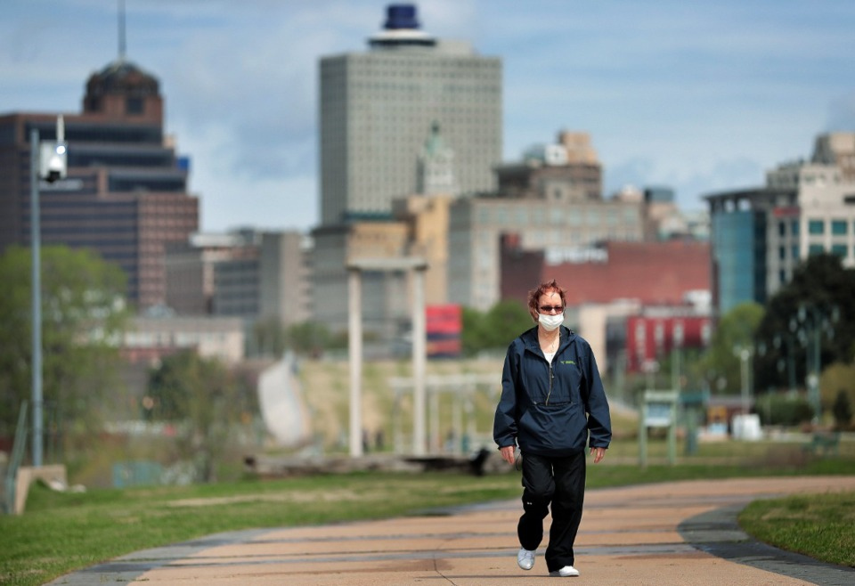 <strong>Downtown Memphis resident Lea Ohara takes a walk through a sparsely populated Tom Lee Park on March, 31, 2020 after Memphis Mayor Jim Strickland announced that the city would start limiting access to city parks, including closing Riverside Drive.</strong> (Jim Weber/Daily Memphian)