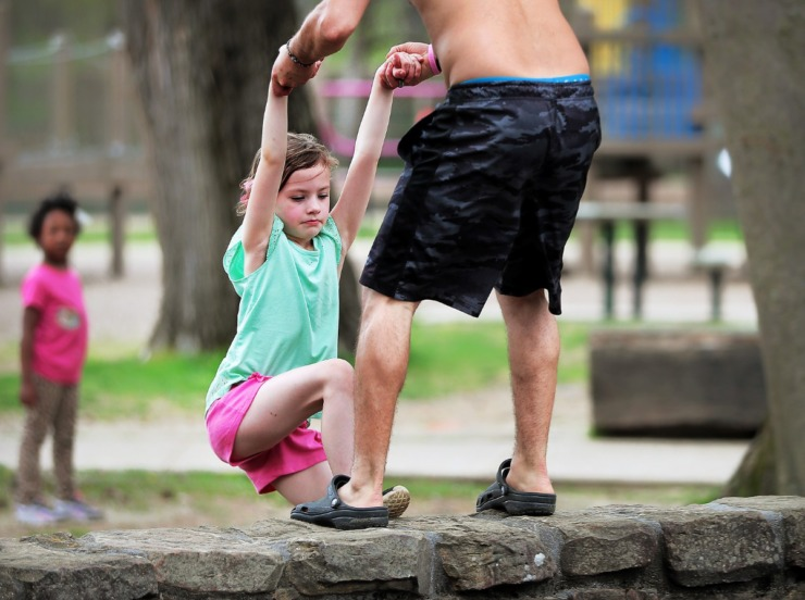<strong>Renzo Gabaldon (right) pulls his niece Hope Jacobs, 7, out of the Overton Park playground after he noticed her inside the wall but some Memphians chose to ignore a posted warning on Friday, March 27, 2020, which is one of the reasons why City officials have threatened to shutter parks entirely.</strong> (Jim Weber/Daily Memphian)