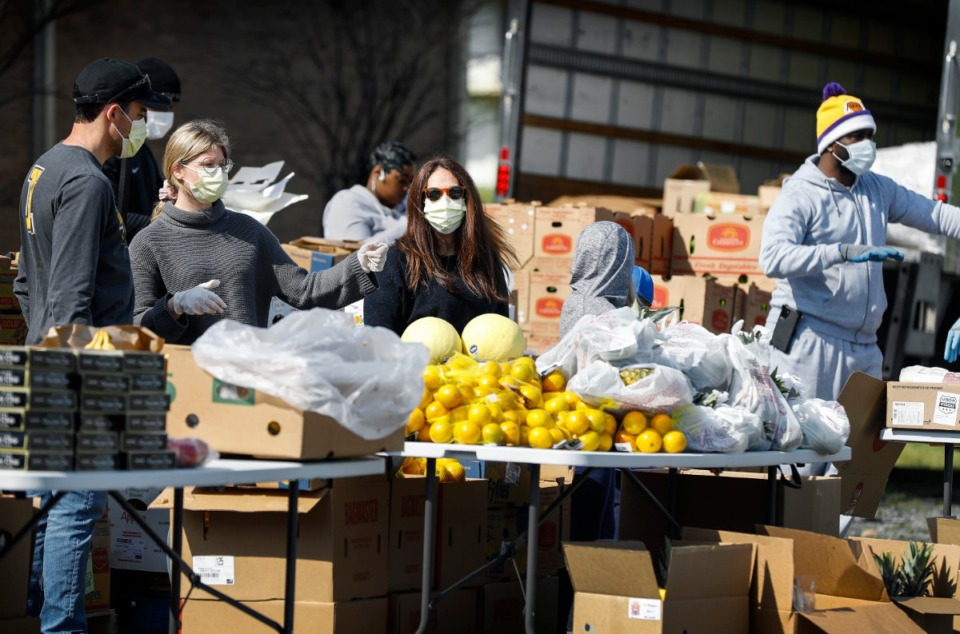 <strong>Mid-South Food Bank volunteers had supplies out to needy families during a food distribution event Wednesday, April 1, 2020, on E. Georgia Ave. The mobile pantry provided household goods, food and baby supplies to nearly 300 families.</strong> (Mark Weber/ The Daily Memphian)