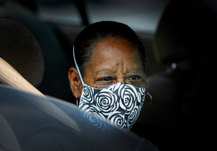 <strong>Carol Webb covers her face with a mask while attending the Mid-South Food Bank mobile pantry event Wednesday, April 1, 2020 on E. Georgia Ave.</strong> (Mark Weber/ The Daily Memphian)
