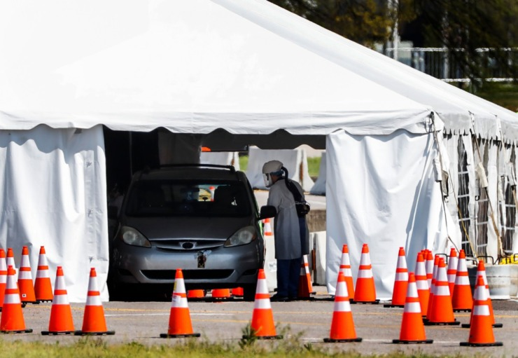 <strong>Staff and students from the University of Tennessee Health Science Center work with the Shelby County Health Department on Wednesday, April 1, 2020, to continue drive-thru testing for COVID-19 at the Memphis Fairgrounds.</strong> (Mark Weber/ The Daily Memphian)