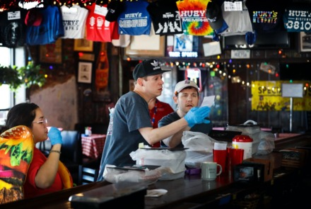 <strong>Huey's employees Chris Featherstone (left) and Jake Hamsley (right) decipher orders during lunchtime on Thursday, April 2, 2020, at the Midtown location.</strong> (Mark Weber/Daily Memphian)