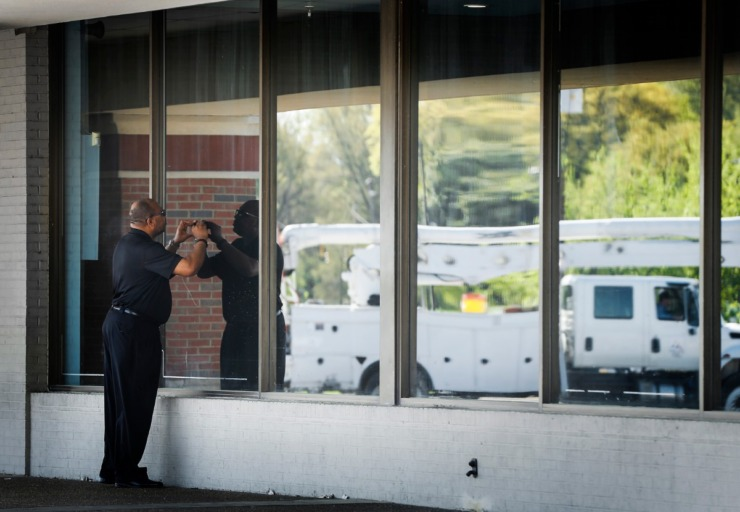 <strong>Keith Norman, Baptist's vice president of Government Affairs, takes pictures of a vacant rental property in Gateway Shopping Center on Thursday, April 2, 2020.</strong> (Mark Weber/Daily Memphian)