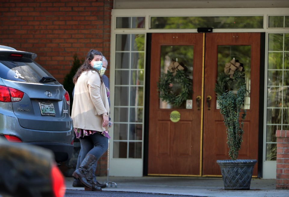<strong>An elderly resident returns home with help from a relative on April 1, 2020, at the Carriage Court assisted living facility in East Memphis where six residents and staff members have tested positive for COVID-19.</strong> (Jim Weber/Daily Memphian)