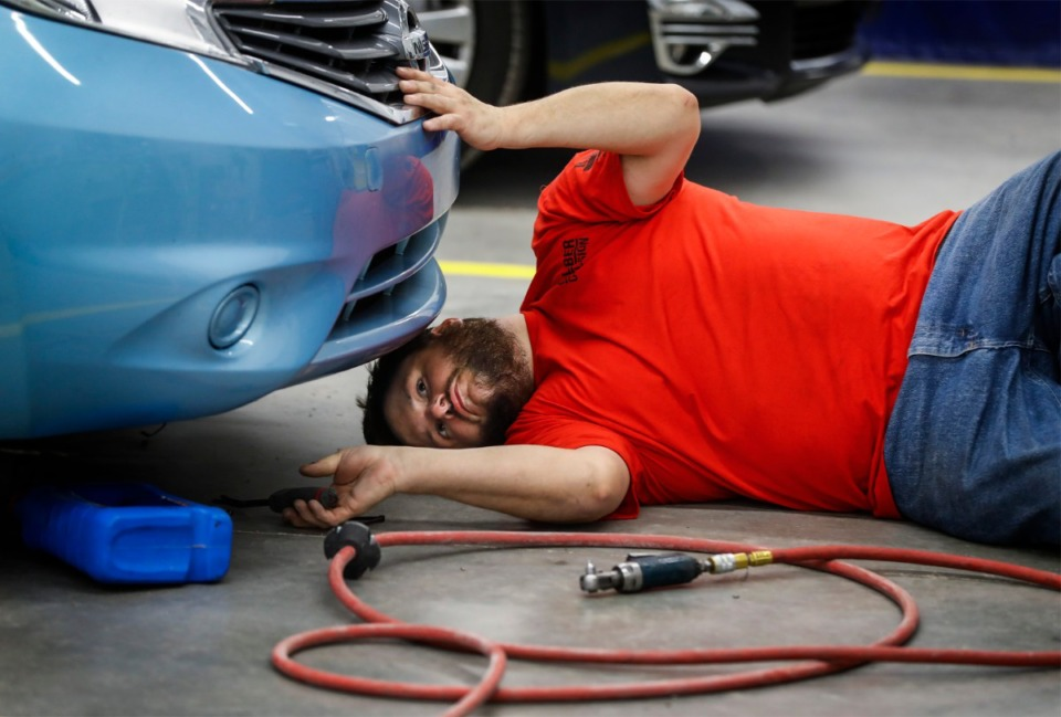 <strong>Caliber Collision technician Andy Davis works on replacing a bumper at their new location in Arlington on March 20, 2020. The company established a Memphis presence last year after merging with ABRA.</strong> (Mark Weber/Daily Memphian)