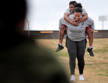 <strong>Bianca Stitts runs down the hill at Beale Street Landing carting her sister Jameka Barr during a workout&nbsp;on April 4, 2020 as Memphians practice social distancing while in public.</strong> (Jim Weber/Daily Memphian)