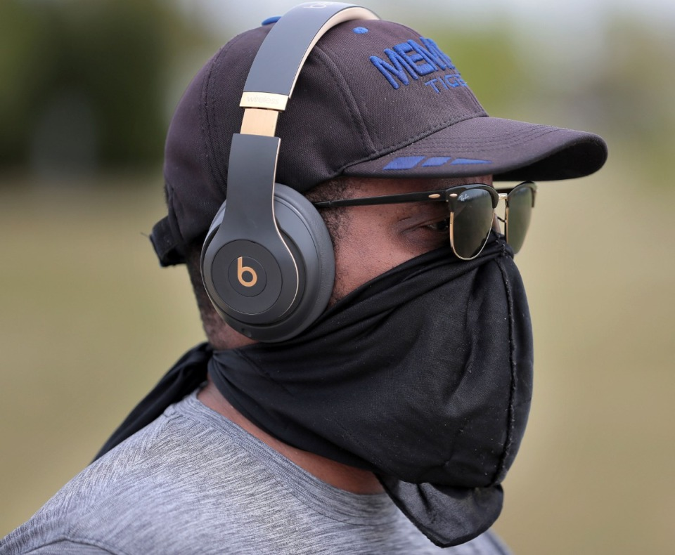 <strong>William Reynolds of Bartlett protects himself while walking at Shelby Farms as Memphians practice social distancing during workouts, dog walks and bike rides either alone or in small groups on April 4, 2020 after concerns over reports of people congregating in city parks, caused Mayor Strickland to issue new restrictions this week.</strong> (Jim Weber/Daily Memphian)