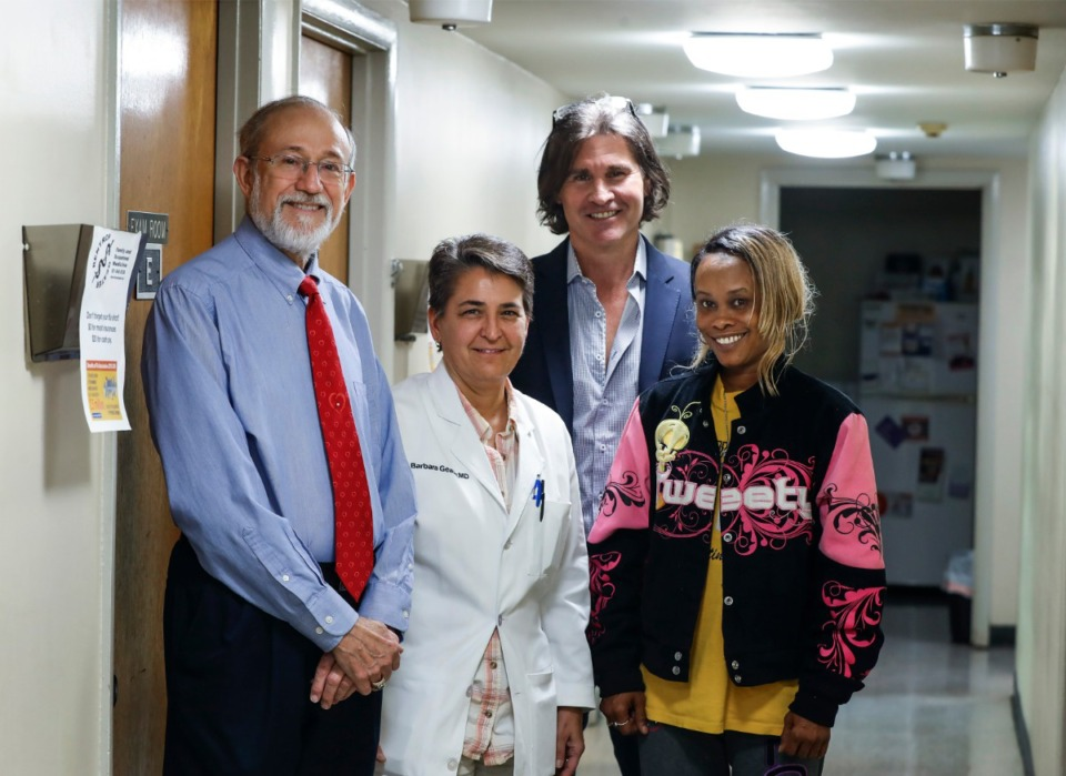 <strong>Dr. David Wright (from left), Dr. Barbara Geater, entrepreneur John Harrison and patient Devonda Harris stand for a picture Wednesday, March 18, 2020 at the Drs. Rentrop and Geater Clinic in South Memphis. The clinic is running a trial for a former Memphis entrepreneur Harrison, who has created a platform to monitor care of people with heart disease, keeping them at home and out of hospital.</strong> (Mark Weber/Daily Memphian)