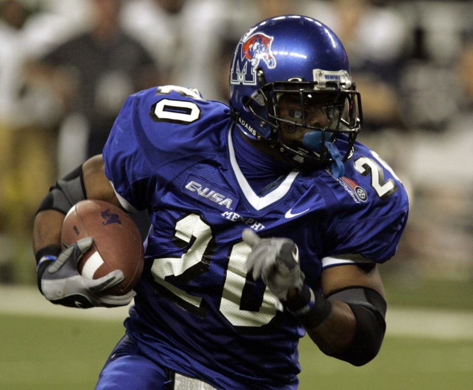 <strong>Former Memphis running back DeAngelo Williams runs during the second quarter in the Motor City Bowl football game at Ford Field in Detroit, Monday, Dec. 26, 2005.</strong> (AP Photo/Carlos Osorio file)
