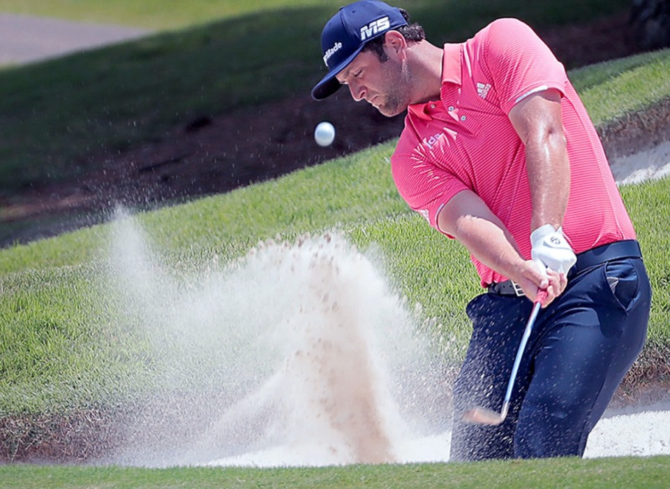 <strong>In the final round of last year's World Golf Championship, Jon Rahm punches a ball out of the rough in Memphis on July 28, 2019.</strong> (Patrick Lantrip/Daily Memphian file)