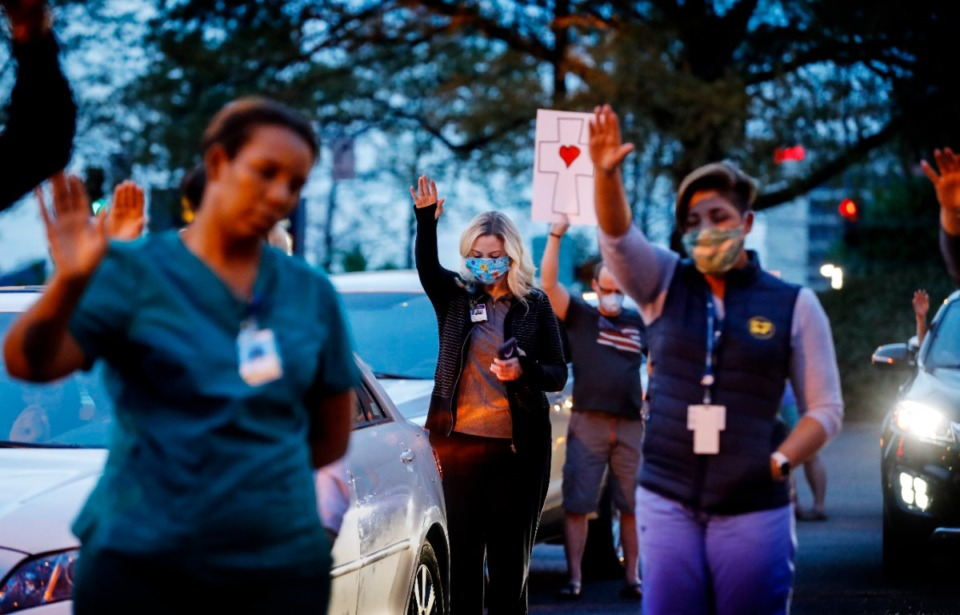 <strong>St. Francis Hospital-Memphis nurses and staff attend a prayer vigil for patients in the parking lot on Monday, April 6, 2020.</strong> (Mark Weber/Daily Memphian)