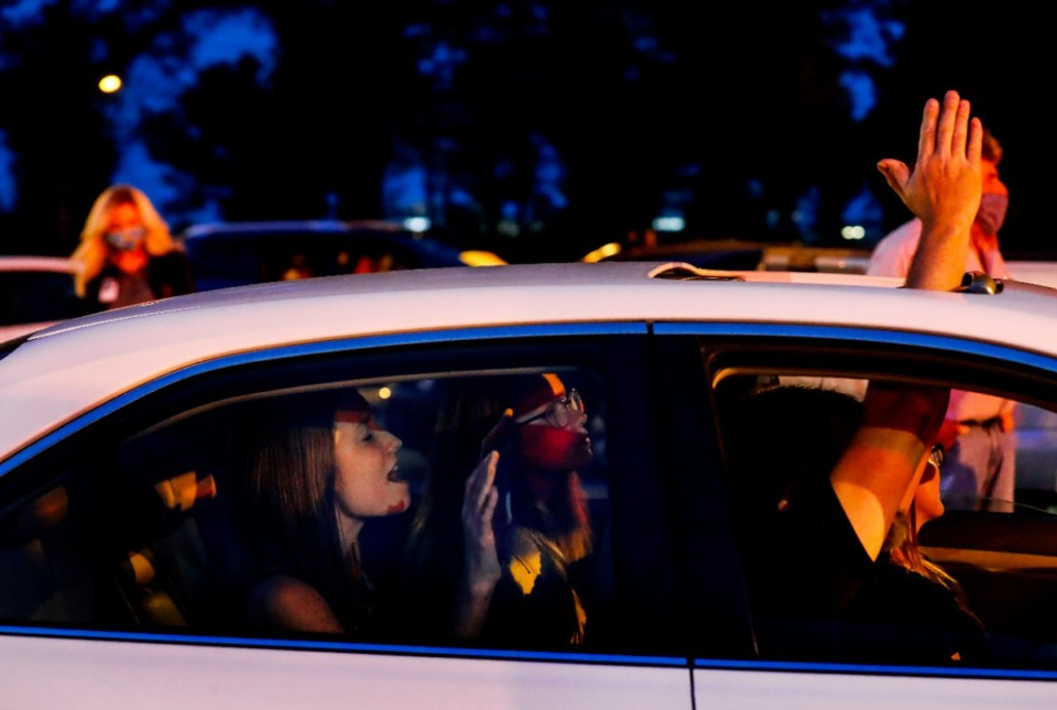 <strong>Rachel Dawson, 17, (left) prays in the backseat with her family while attending a vigil for patients and staff in the St. Francis Hospital-Memphis parking lot on Monday, April 6, 2020.</strong> (Mark Weber/Daily Memphian)