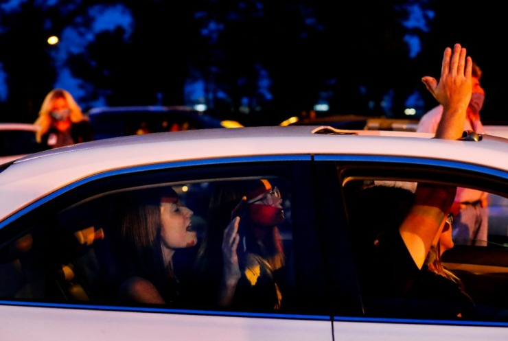 <strong>Rachel Dawson, 17, (left) prays in the back seat with her family&nbsp;while attending a prayer vigil in the hospital parking lot for patients and staff on Monday, April 6, 2020.</strong> (Mark Weber/Daily Memphian)
