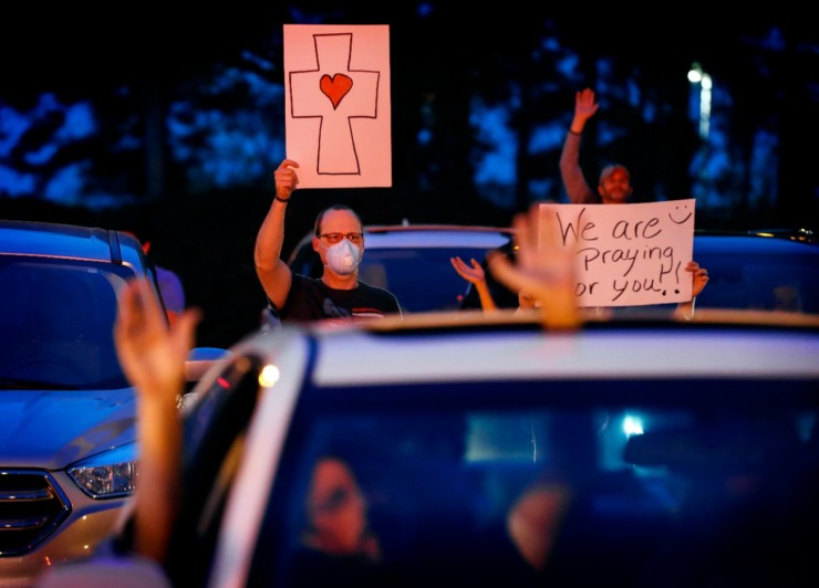 <strong>Kelley Brown (top) attends a prayer vigil for patients and staff in the St. Francis Hospital-Memphis parking lot on Monday, April 6, 2020.</strong> (Mark Weber/Daily Memphian)