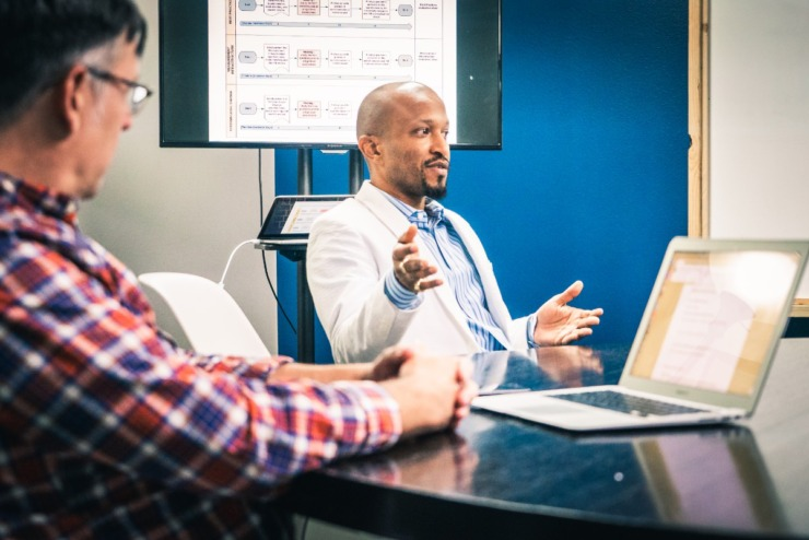 """<ol start=""""3""""></ol><p style=""""font-weight: 400;""""><strong>Dr. Doug Campbell, Slingshot's chief knowledge officer (left) and Yoan&nbsp;Anguilet, Slingshot's chief data and strategy officer, attend a working session.</strong> (Submitted/David Roseberry)&nbsp;"""