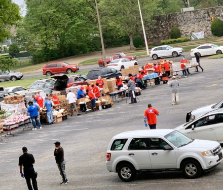 <strong>Volunteers helped distribute meals to almost 500 families on Wednesday, April 8, in a drive-thru pick-up location in the parking lot of Shelby County Schools' Board of Education.</strong> (Submitted)