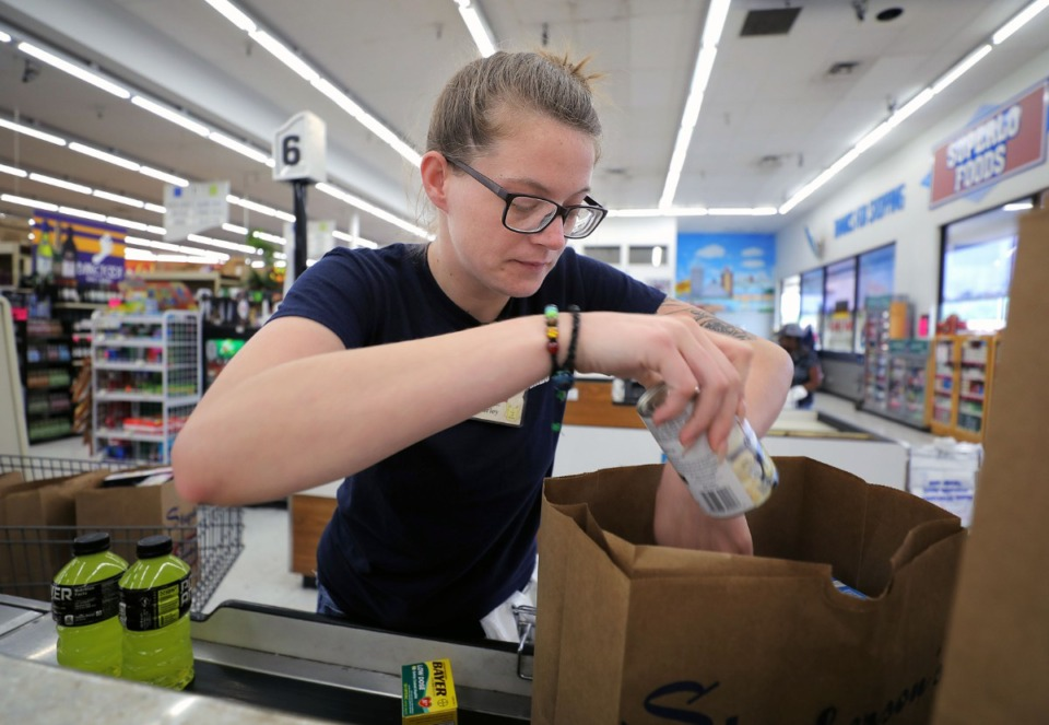 <strong>Superlo employee Harley Schroyer bags a pick-up order of groceries at the store's East Memphis location April 8, 2020.</strong> (Patrick Lantrip/Daily Memphian)